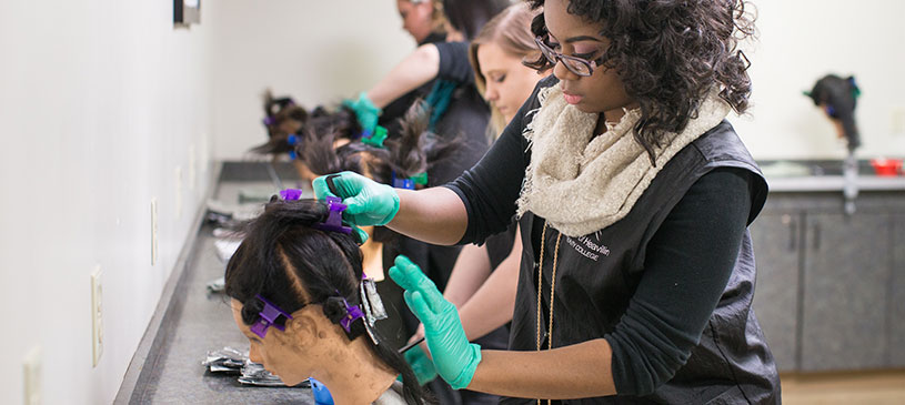 cosmetology student working on hair