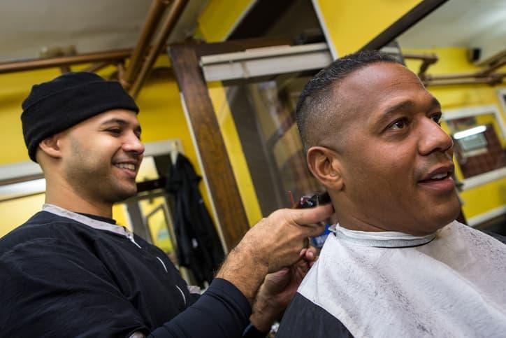 Getting haircut at barber school in Charlotte, North Carolina