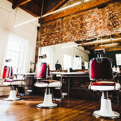 empty chairs at a barber school