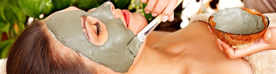 Esthetician Applying a Facial to Client