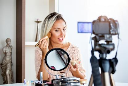 woman recording her makeup application