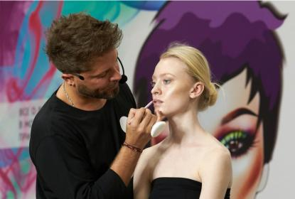 Man doing makeup demonstration