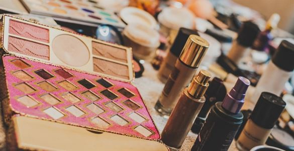 various makeup laid out on a table